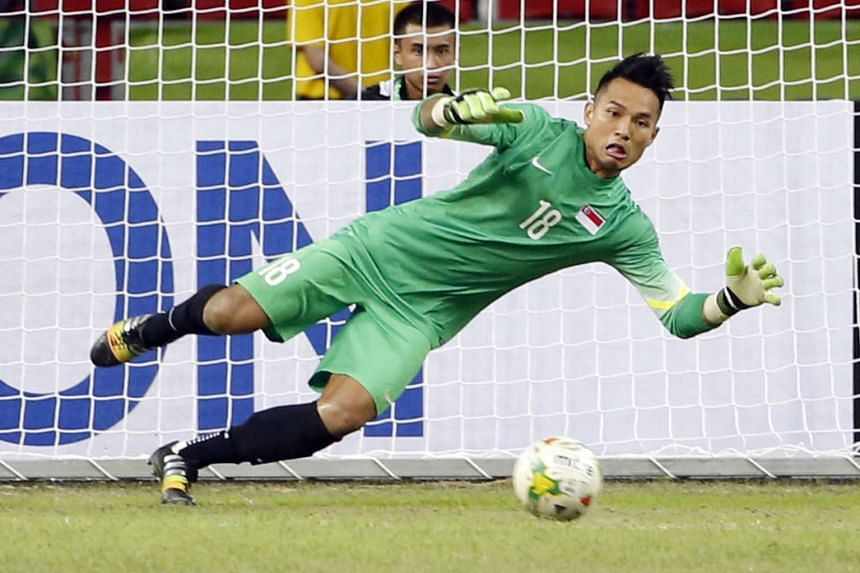 Singapore's Hassan Sunny in action against Myanmar in the AFF Suzuki Cup at the National Stadium, on Nov 26, 2014.