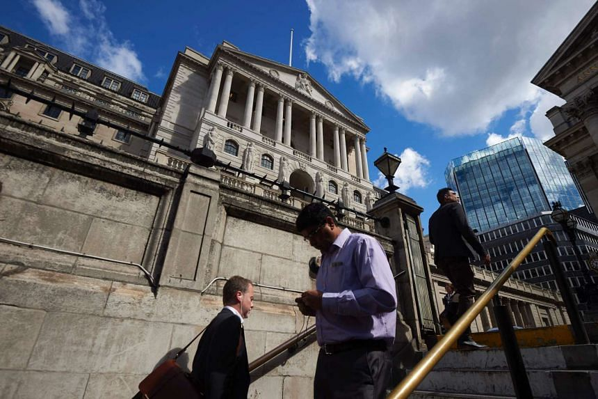 Pedestrians walk on the subway stairs outside the Bank of England in London, on July 14, 2016.