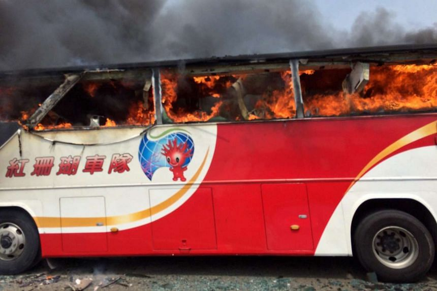 A tourist coach in flames near the Taoyuan International Airport outside Taipei, Taiwan, on July 19, 2016.