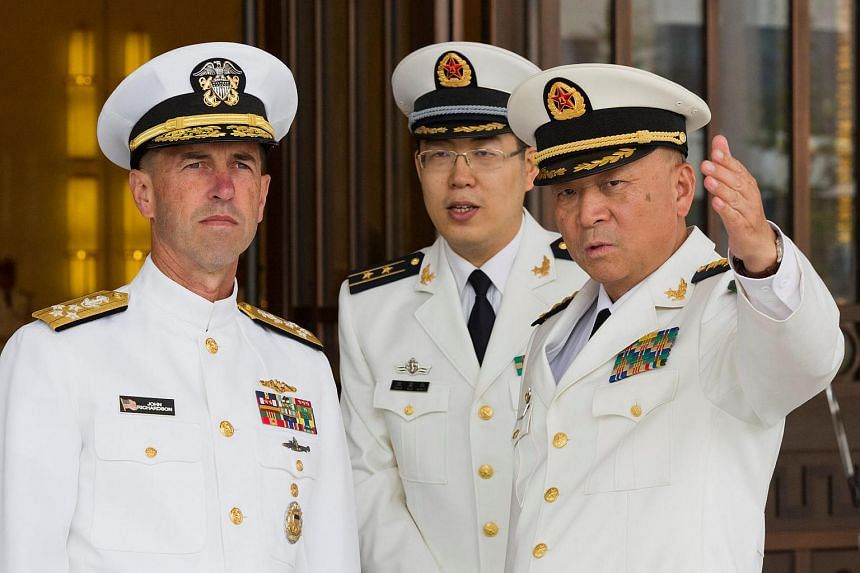 Commander of the Chinese navy, Admiral Wu Shengli points out the layout of the Chinese Navy Headquarters to visiting US Chief of Naval Operations Admiral John Richardson (left) during a welcome ceremony held at the Chinese Navy Headquarters in Beijin