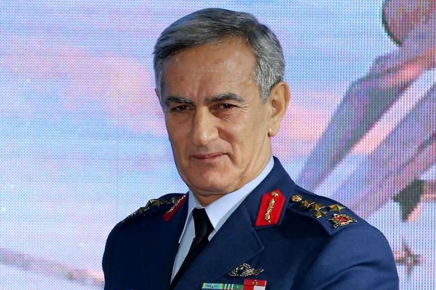 Akin Ozturk posing for the media in a 2013 file photo.