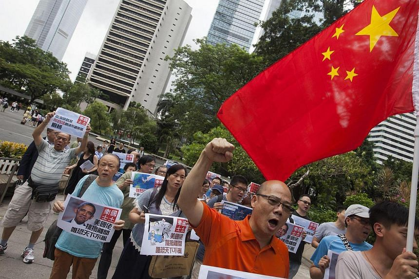People gather in Hong Kong's Chater Garden to protest the UN Permanent Court of Arbitration in the Hague ruling on the West Philippine Sea, formerly known as the South China Sea, in the Central District, Hong Kong, China, July 14.