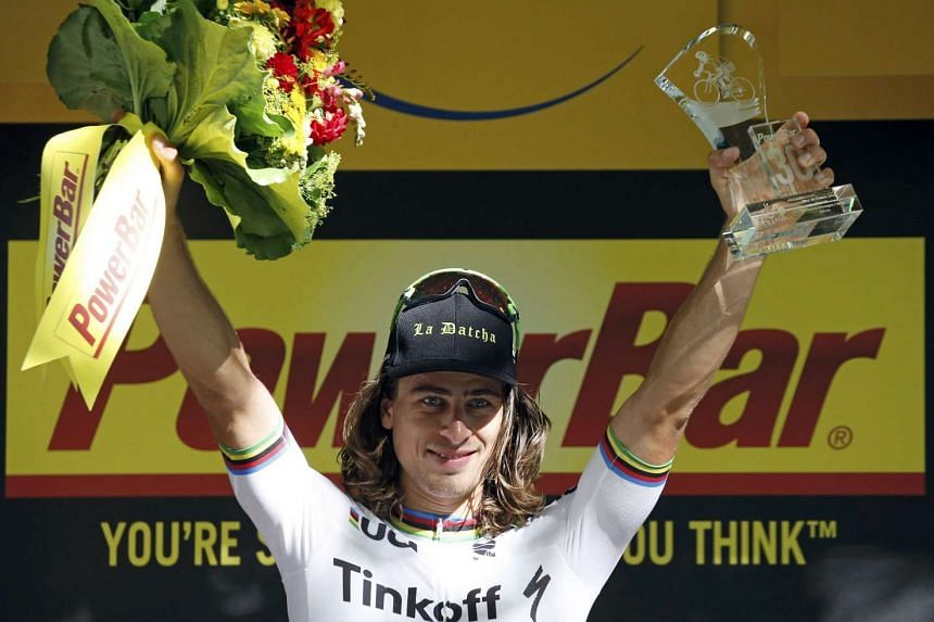 Peter Sagan of Slovakia celebrates on the podium after winning the stage.