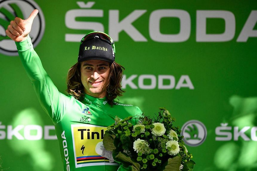 Slovakia's Peter Sagan celebrates on the podium at the end of the 209 km sixteenth stage of the 103rd edition of the Tour de France.