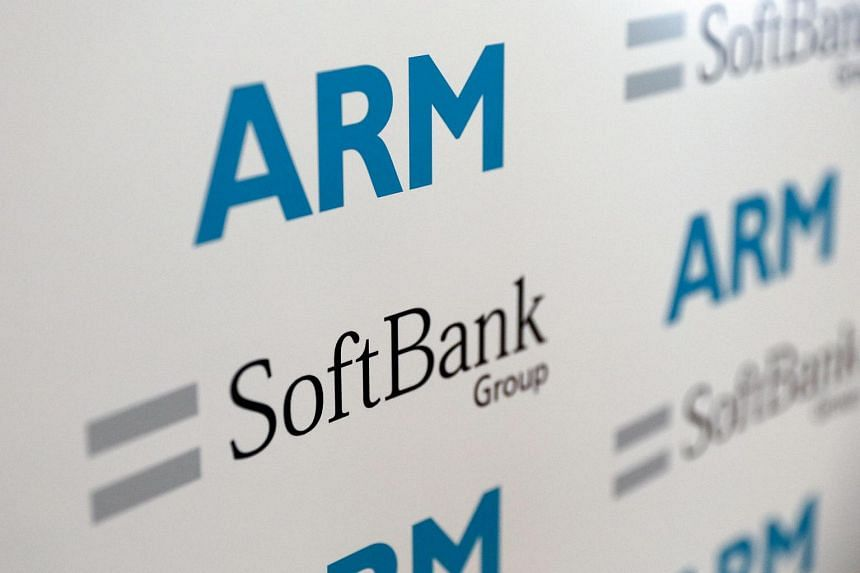 Logos of ARM Holdings and SoftBank sit on a background during a news conference in London, July 18.
