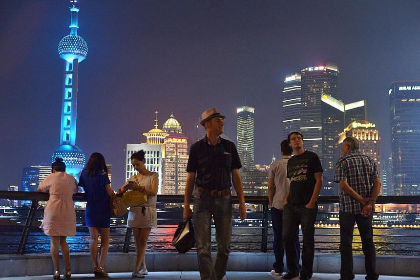 Visitors at the Bund, the west side of the city in Pudong, Shanghai.