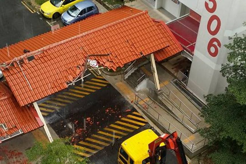 A lorry crane damaged a covered walkway in Bukit Batok on July 20, 2016.