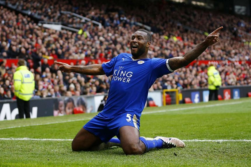 Leicester City's Wes Morgan celebrates scoring a goal against Manchester United.