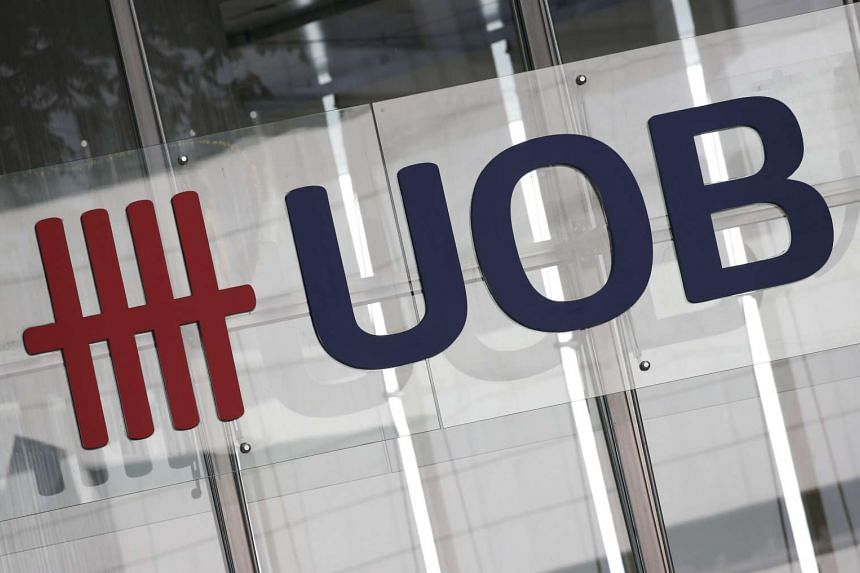 A logo of the United Overseas Bank Limited (UOB) outside a branch in Singapore's central business district.