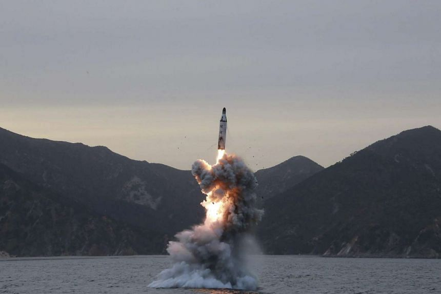 An 'underwater test-fire of strategic submarine ballistic missile' conducted at an undisclosed location in North Korea.