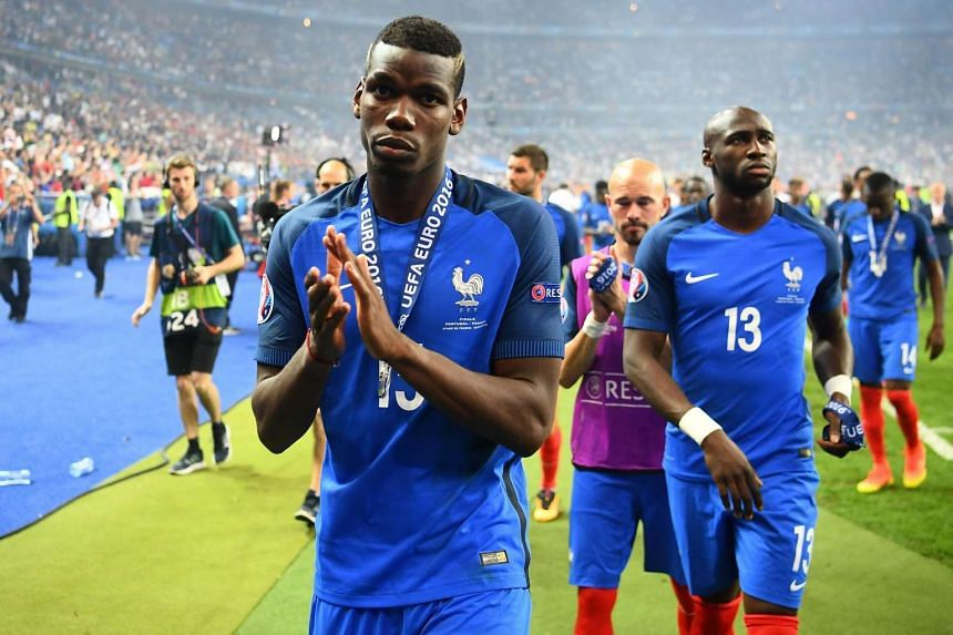 France's midfielder Paul Pogba acknowledges the fans after France lost to Portugal 1-0 in Euro 2016 final football match between France and Portugal at the Stade de France in Saint-Denis, Paris, on July 10.