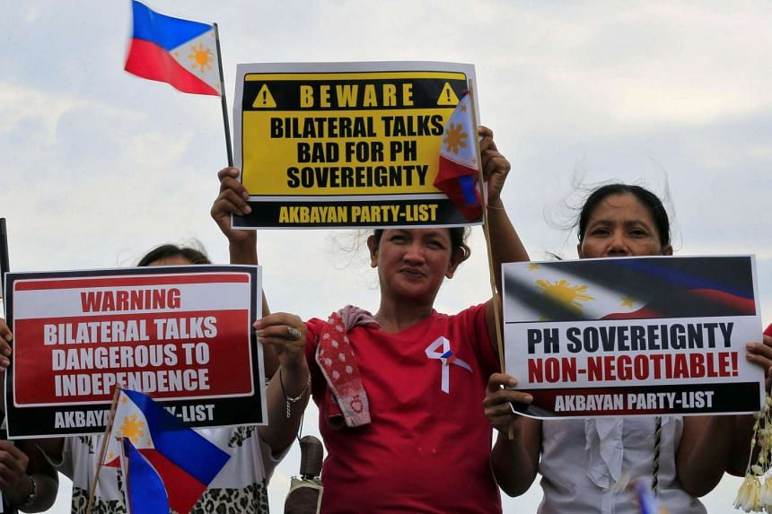 Protesters during a rally by different activist groups over the South China Sea disputes, along a bay in metro Manila, Philippines on July 12.