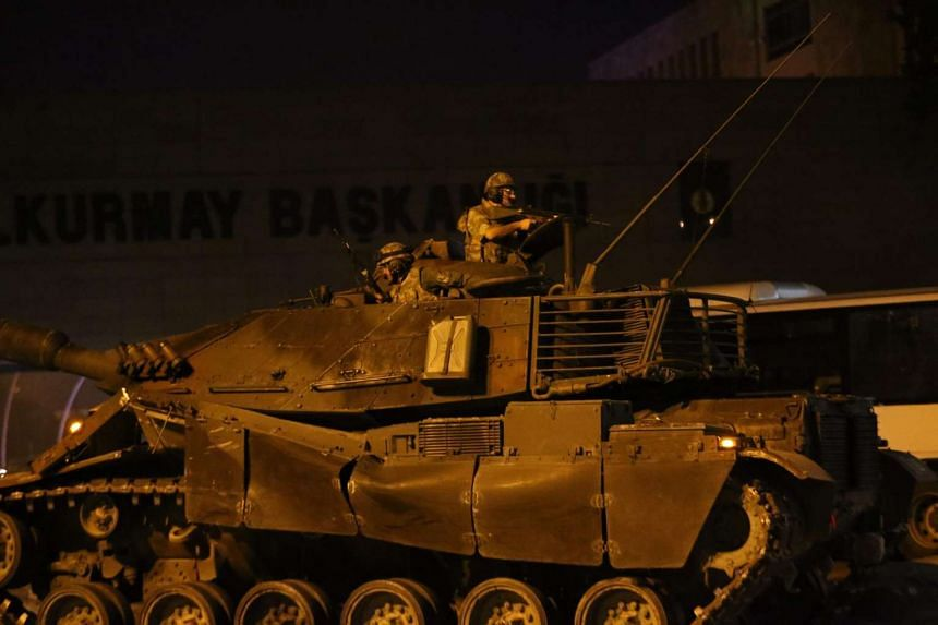 A tank drives on streets in Ankara, Turkey as people protest against a military coup on July 16, 2016.