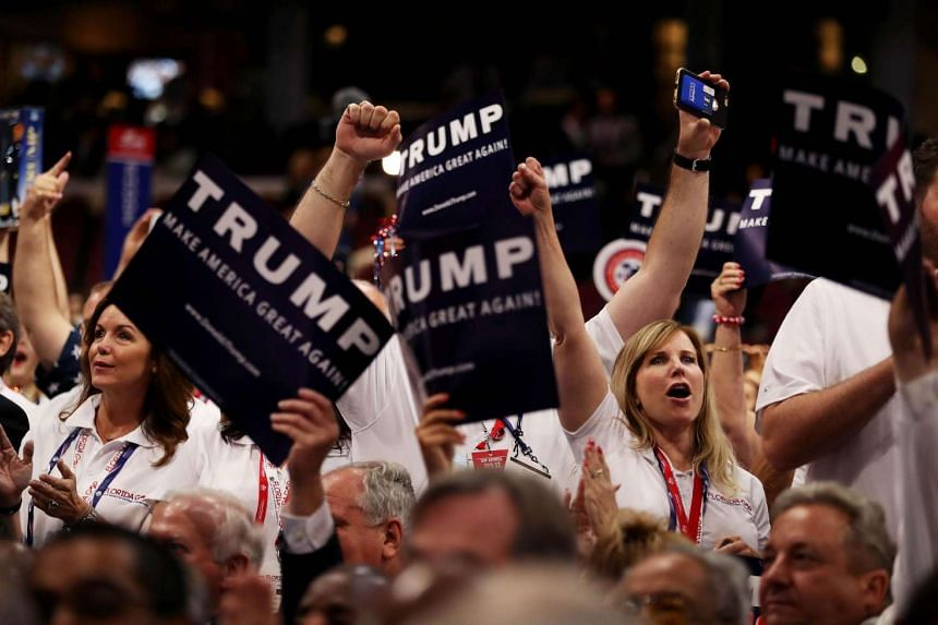 Delegates supportive of Mr Donald Trump during a roll call on the second day of the Republican National Convention on July 19 at the Quicken Loans Arena in Cleveland, Ohio.