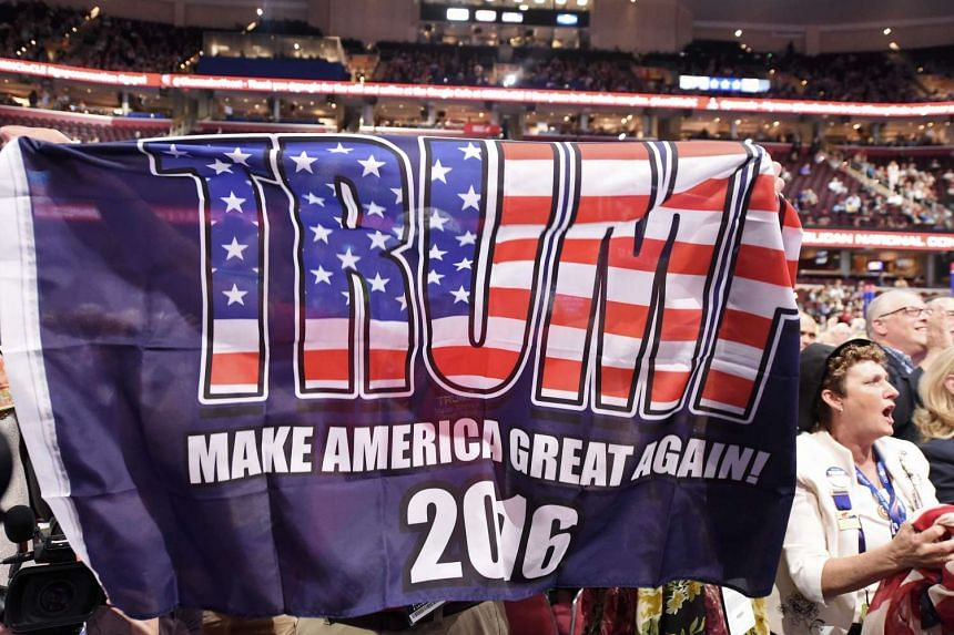 A huge banner is waved during the roll call of states on the second day of the Republican National Convention on July 19, 2016 at Quicken Loans Arena in Cleveland, Ohio.