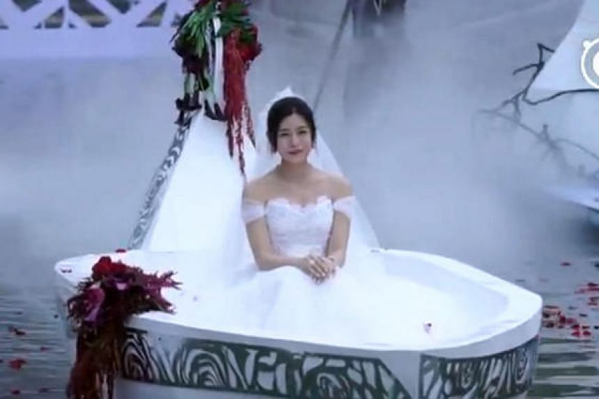 Actress Michelle Chen emerged on a white boat for her wedding ceremony with Chinese actor Chen Xiao on Tuesday night (July 19).