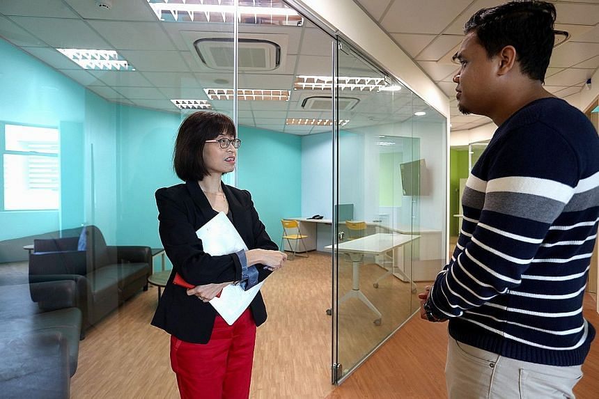 Sana para-counsellor Koh Joh Ting having a chat with Mr Ridzwan at the Step-Up Centre. Besides counselling and mediation services, the centre also provides legal aid and financial help.