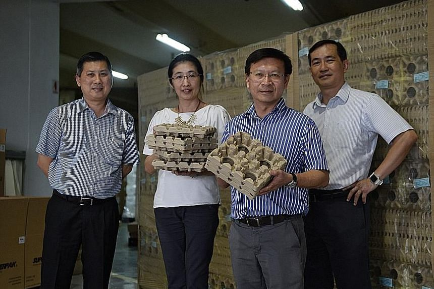 Mr Long (right in photo), with other Super Pak staff, (from left) corporate quality assistance manager Yang Kian Jou, engineering manager Ong Bee Lan, and business process manager Ong Kok Hin.