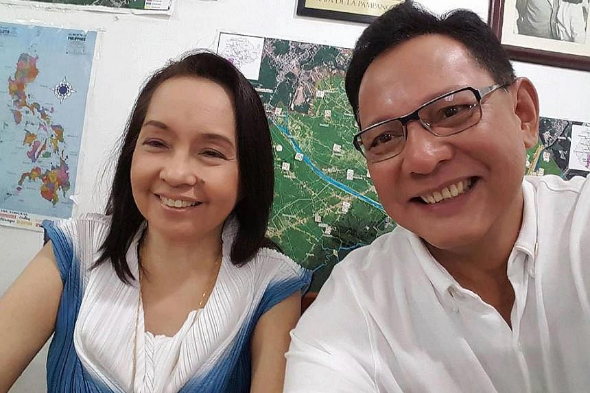 Mrs Arroyo with her lawyer, Mr Raul Lambino, in an undated selfie. She has been cleared of stealing $12.2 million from the state lottery firm when she was president of the Philippines from 2004 to 2010.