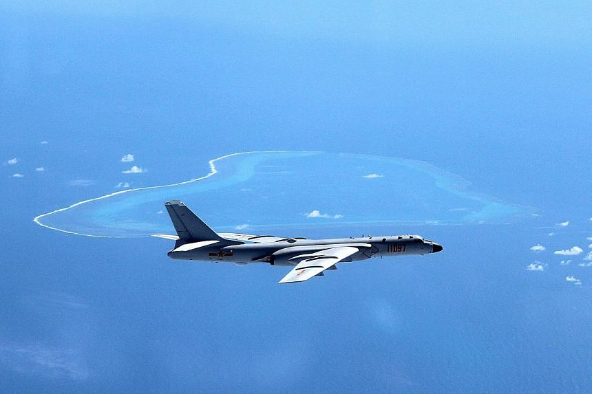 A Chinese H-6K bomber patrolling the South China Sea in an undated photo. In his congratulatory note to China to commemorate 25 years of dialogue partnership yesterday, Asean secretary-general Mr Minh reminded the country of a 2002 agreement to exerc