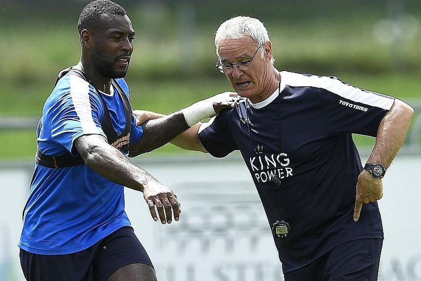 """Defender Wes Morgan with Leicester manager Claudio Ranieri on July 14. """"To win (the EPL) is a dream,"""" Ranieri said."""