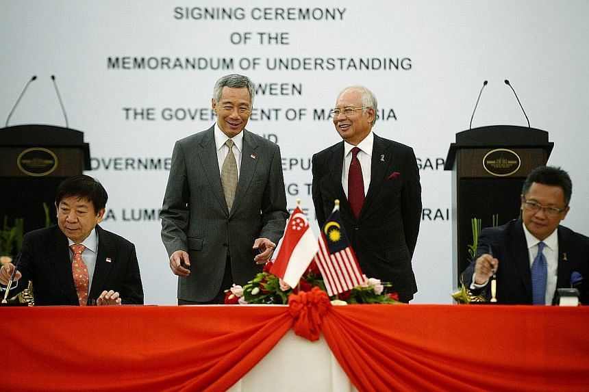 PM Lee and Mr Najib witnessing the signing of the high-speed rail MOU by Mr Khaw and Mr Abdul Rahman in Putrajaya yesterday. Three services will run along the rail line that will have eight stations, of which one will be in Singapore - at Jurong East