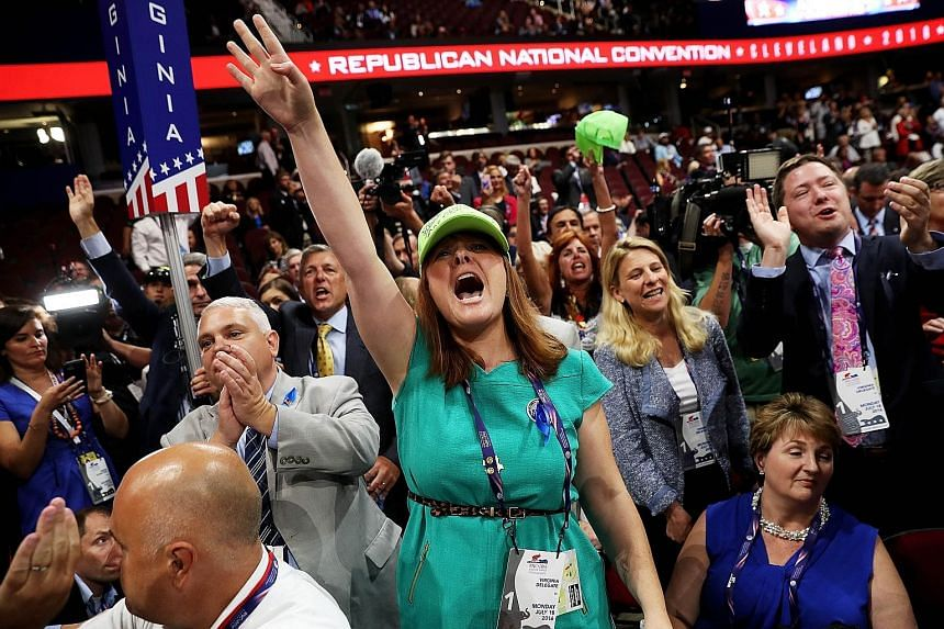 A delegate from Virginia opposing a roll-call vote on the first day of the Republican National Convention on Monday. More than once, the delegates on the floor broke into deafening boos and chants as pro- and anti-Trump forces faced off in a shouting