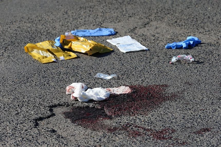 A pavement near Wuerzburg yesterday after Monday's train attack. The Afghan teen, wielding an axe and knife, seriously injured four Hong Kong tourists. Other passengers suffered minor injuries.