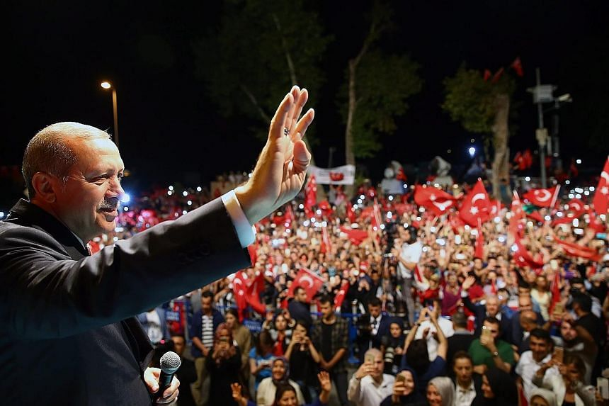 President Erdogan at a midnight rally in Istanbul on Monday. The Turkish leader and government accuse US-based Mr Gulen of orchestrating last Friday's abortive military takeover. The subsequent and ongoing crackdown, and calls to reinstate the death