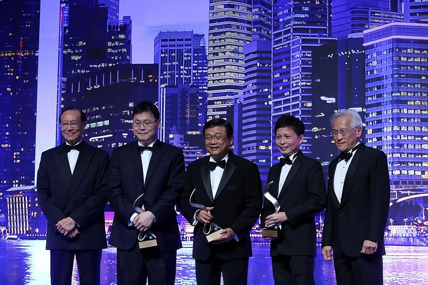 At the awards last night were (from left): presenter John Lim, immediate past chairman of the Singapore Institute of Directors, Best CEO winners William Liem, Lim Ee Seng and Kong Chee Min; and presenter Chew Choon Seng, chairman of Singapore Exchang
