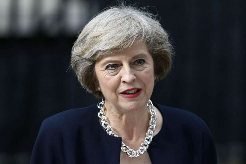 Britain's new Prime Minister Theresa May speaks outside 10 Downing Street in central London on July 13.