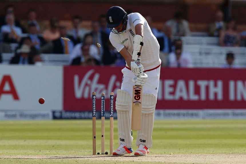 England's Jake Ball loses his wicket for for 3 runs off the bowling of Pakistan's Mohammad Amir on the fourth day of the first Test cricket match between England and Pakistan at Lord's cricket ground in London, on July 17.