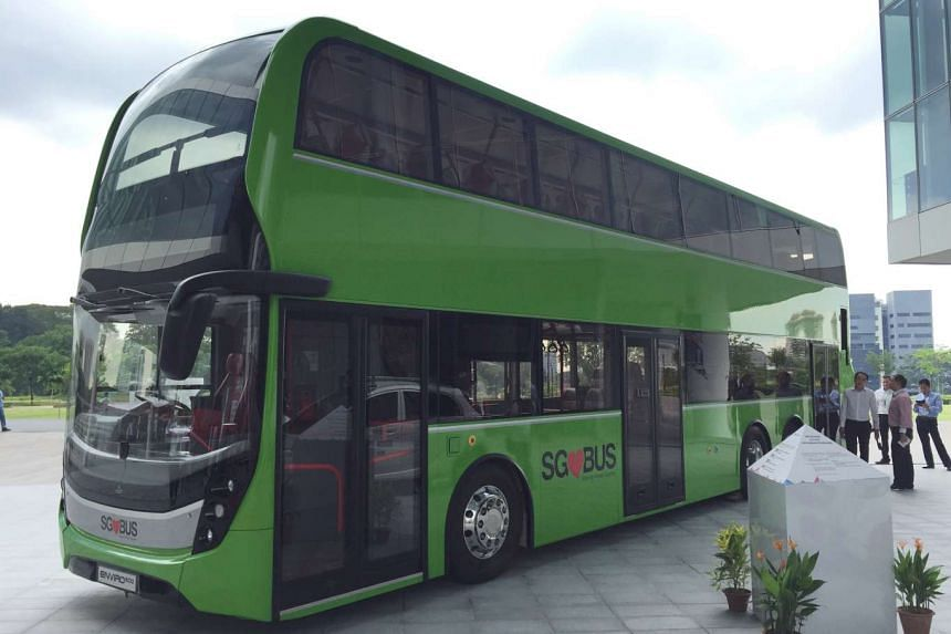 Concept bus on display which features more foldable seats, shared space to secure prams and foldable bikes, USB ports to charge devices, and three doors and two staircases for easier boarding and disembarking.