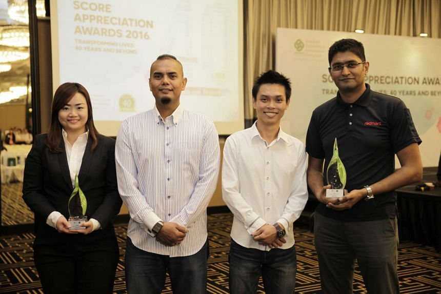Ms Ong Pau Hsing Juliana, Director of Human Resource, Mr Shaharuddin Mokhtar, Mr Desmond Koh and Mr Jamil Khan, Vice President of Operations, at the Score Appreciation Awards 2016.