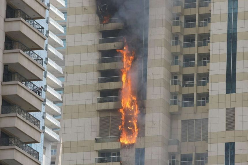 Flames are seen after a fire broke out at the Sulafa tower in Dubai's Marina district on July 20, 2016.