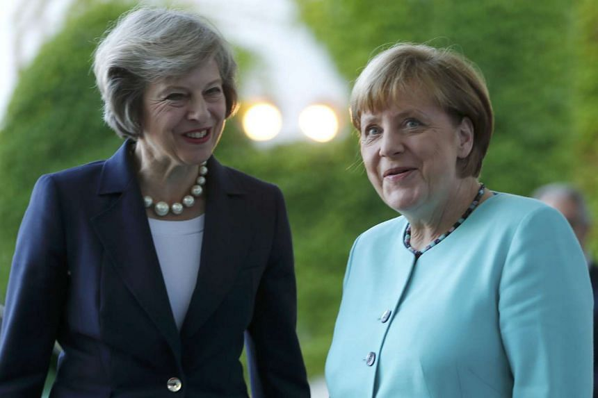 German Chancellor Angela Merkel (right) greets British Prime Minister Theresa May for talks in Germany, on July 20, 2016.