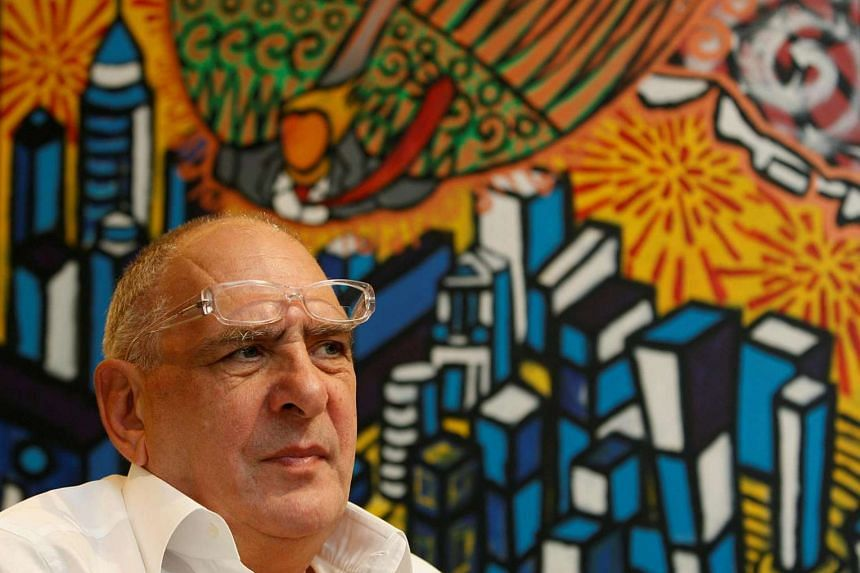 Noble Group CEO Richard Elman listens during an interview in Hong Kong.