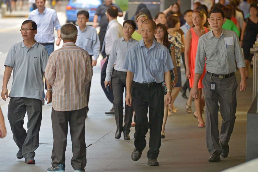 Workers at Raffles Place on June 13.