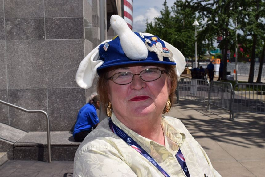 Fervent Republican and Donald Trump supporter in her elephant cap outside The Q in Cleveland.