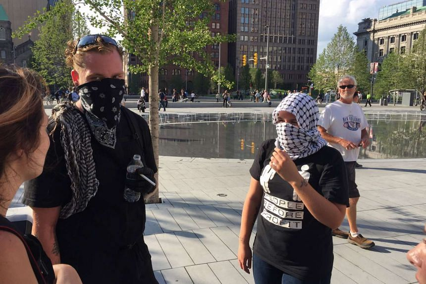 Protesters whom identified themselves as members of the Anonymous social site protest group gather on Cleveland's Public Square near fthe Republican Convention.