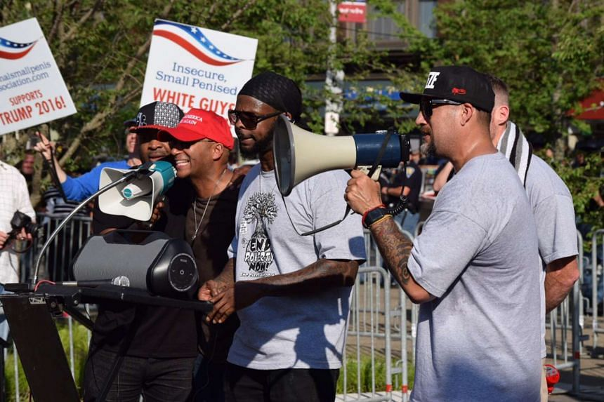 Tom Morello (In red cap) of rap rock band Rage Against the Machine leads his new supergroup Prophets of Rage in musical protest of the Republican convention in Cleveland's Public Square much to the delight of surprised fans.