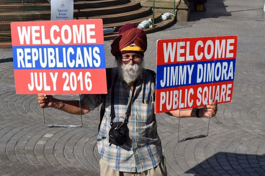 A Sikh man shares his feelings about money spent on Cleveland'S Public Square renovations, with a Cleveland Cavaliers headband under his turban. Jimmy Dimora is a former Cleveland official now serving 28 years in prison for corruption.
