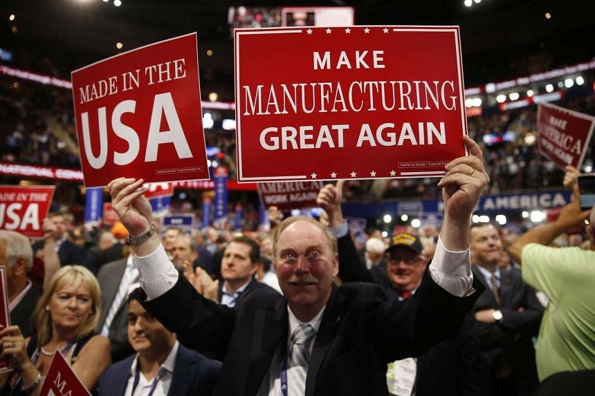 A delegate holds signs during the Republican National Convention (RNC) in Cleveland, Ohio, US, on July 19.