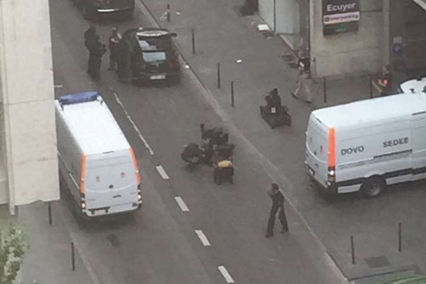A photo uploaded to Twitter after police surrounded a bomb suspect in Brussels.