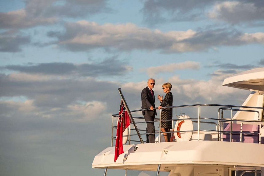 US Vice President Joe Biden and Australian Foreign Minister Julie Bishop ride onboard a boat during a cruise on Sydney Harbour on July 19.