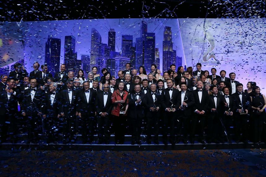 Celebrations onstage at the Singapore Corporate Awards presentation jointly organised by the Institute of Singapore Chartered Accountants, Singapore Institute of Directors and The Business Times.