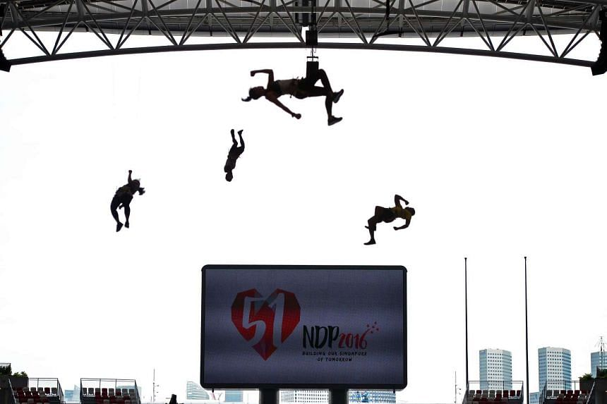 Aerialists from the SAF MDC unit training for the National Day Parade on July 21, 2016.