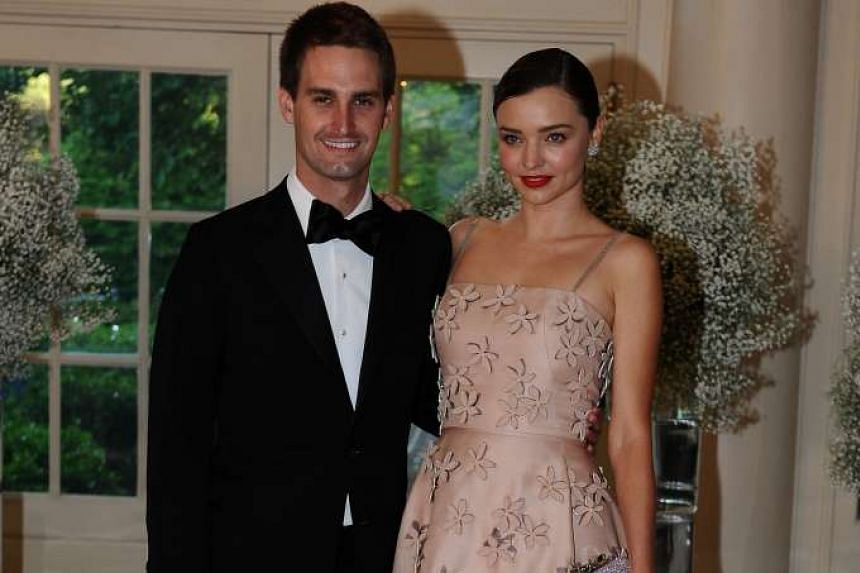 Evan Spiegel, Chief Executive Officer, Snapchat and model Miranda Kerr arrive for the state dinner in honor of the Nordic Summit at the White House in Washington on May 13.