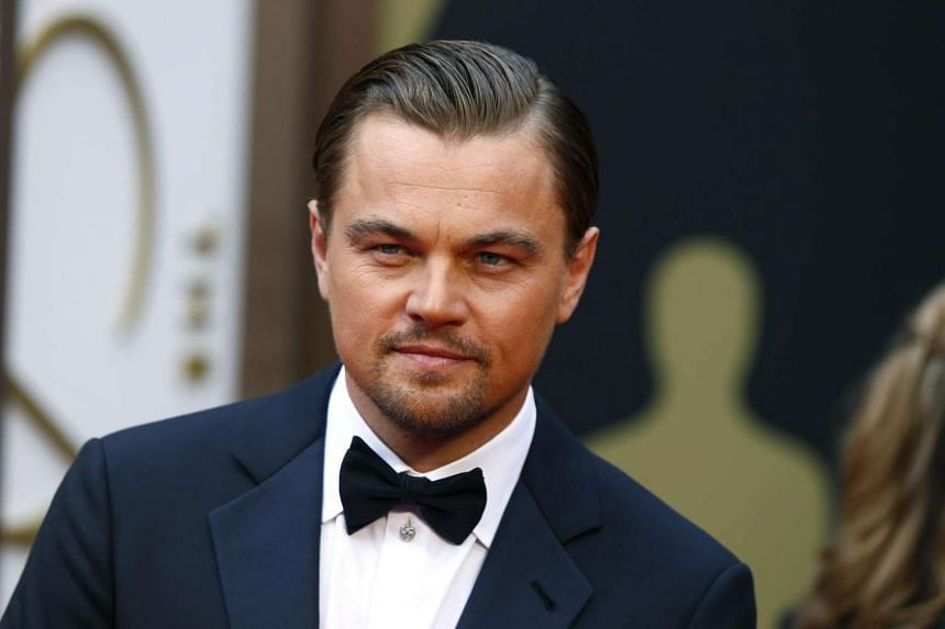 """Leonardo DiCaprio, best actor nominee for his role in """"The Wolf of Wall Street,"""" arrives at the 86th Academy Awards in Hollywood, California, on March 2, 2014."""