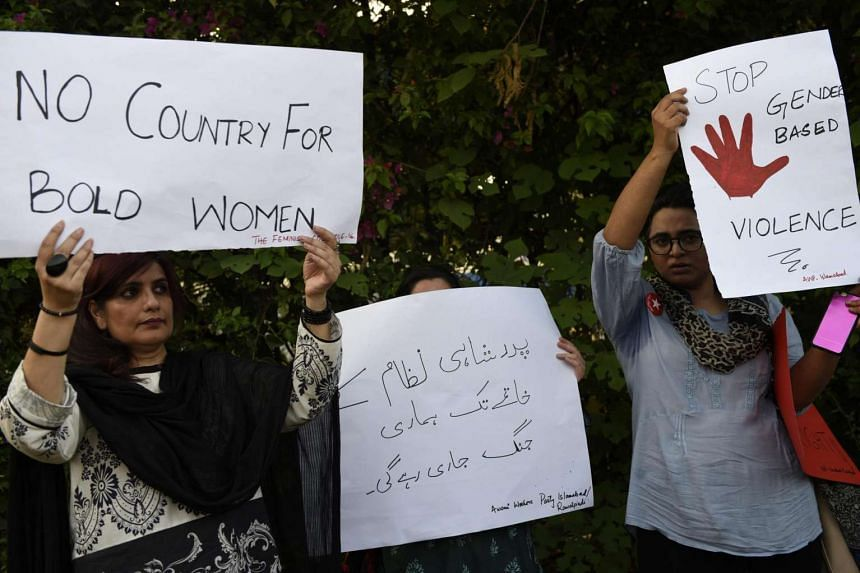 Pakistani people hold placards at a protest against honour killings in Islamabad, Pakistan, on July 18, 2016.